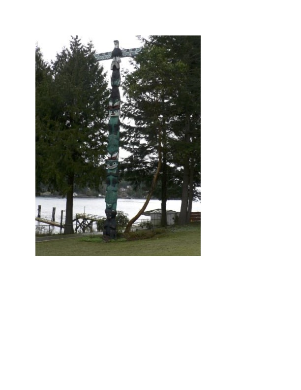 A traditional Salish spiritual Totem Pole. There are white spots on the pole that are eyes, representing access to the spirit world. From the top-down: the first figure is an eagle, which is a spirit messenger; the second figure is a black fish, which is a spirit messenger of the underworld; the killer wale, guardian of the underworld, is the third figure; the fourth figure is a transformation figure, which represents the Chief being transformed into a bear; the fifth figure is a frog; the sixth figure would be the Chief, fully transformed into a bear; the next figure is another frog, which is another transformation figure; and the bottom of the pole is a black bear. It represents the clan.